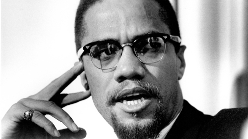 (FILE PHOTO) On February 21 it will be the 50th Anniversary of the Assassination Of Malcolm X. ROCHESTER, NY - FEBRUARY 16: Former Nation Of Islam leader and civil rights activist El-Hajj Malik El-Shabazz (aka Malcolm X and Malcolm Little) poses for a portrait on February 16, 1965, in Rochester, New York. (Photo by Michael Ochs Archives/Getty Images)